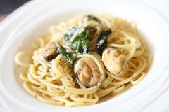 Spaghetti with mussel and olive oil. On a plate stock photo