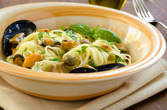 Spaghetti with mussels and capers Stock Photography