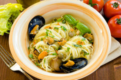 Spaghetti with mussels and capers Stock Images