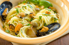 Spaghetti with mussels and capers Stock Image