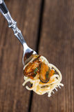 Spaghetti with Mussels on a fork Royalty Free Stock Photography