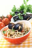 Spaghetti with mussels and fresh tomatoes Stock Image