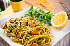 Spaghetti with mussels meat and pesto Stock Image