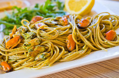 Spaghetti with mussels meat and pesto Stock Images