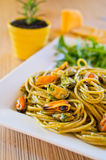 Spaghetti with mussels meat and pesto Stock Photo