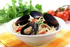 Spaghetti with mussels and parsley Stock Image
