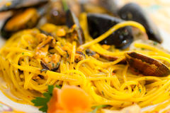 Spaghetti with mussels and Saffron. Royalty Free Stock Photos