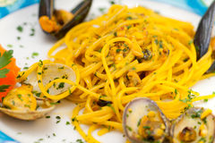 Spaghetti with mussels  and Saffron. Stock Images