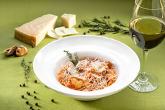 Spaghetti with mussels, tomato sauce and basil on green backgrou Stock Photos