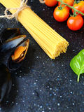Spaghetti with mussels, tomatoes and basil Stock Photo