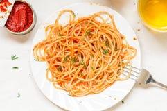 Spaghetti Napoli pasta with tomato sauce and wine Stock Photos