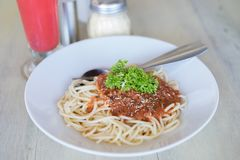 Spaghetti Napoli on table in restaurant. Spaghetti Napoli on table in restaurant Royalty Free Stock Photography