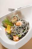 Spaghetti neri dei frutti di mare Immagine Stock