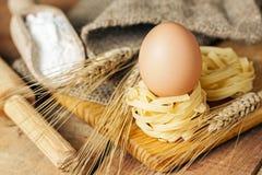 Spaghetti nest and eggs royalty free stock photo