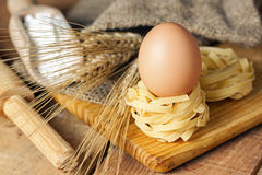 Spaghetti nest and eggs royalty free stock images