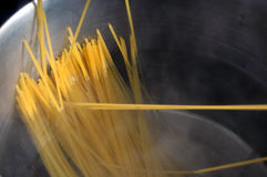 Spaghetti noddles boiling in large pan Royalty Free Stock Photo