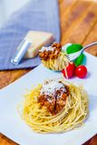 Spaghetti noodles with bolognese minced meat sauce served on a f royalty free stock photos