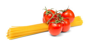 Spaghetti noodles and tomatoes Stock Photography