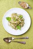 Spaghetti with nuts and basil Stock Images