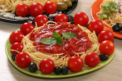 Spaghetti with olives Stock Images