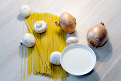 Spaghetti, onion, mushrooms and cream in a bowl Stock Images