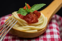 Spaghetti over wooden spoon Stock Photos