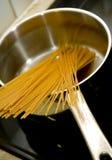 Spaghetti in pan royalty free stock photos