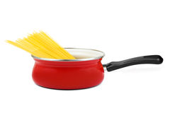 Spaghetti in pan. Isolated on white background Royalty Free Stock Image