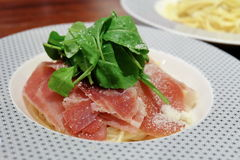 Spaghetti with Parma ham and cheese. Delicious Spaghetti with Parma ham and cheese Stock Photos