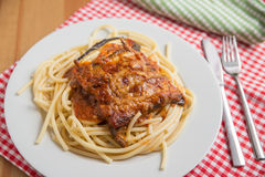 Spaghetti with Parmigiana di melanzane Stock Photo