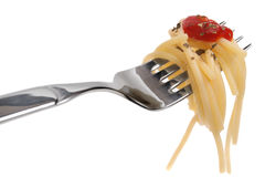 Spaghetti pasta. And tomato sauce twirled on a fork stock photos