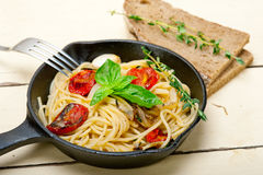 Spaghetti pasta with baked cherry tomatoes and basil Stock Image