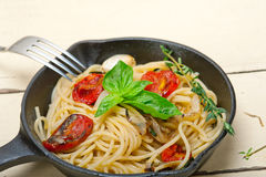 Spaghetti pasta with baked cherry tomatoes and basil Royalty Free Stock Photo