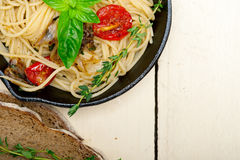 Spaghetti pasta with baked cherry tomatoes and basil Stock Photos
