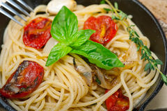 Spaghetti pasta with baked cherry tomatoes and basil Royalty Free Stock Photography