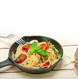 Spaghetti pasta with baked cherry tomatoes and basil Royalty Free Stock Image