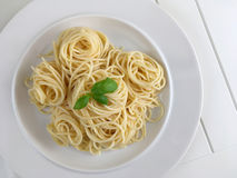 Spaghetti pasta with basil herbs. White background. Top view. Royalty Free Stock Photography