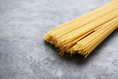 Spaghetti pasta. Bunch of spaghetti pasta on grey wooden table Stock Images