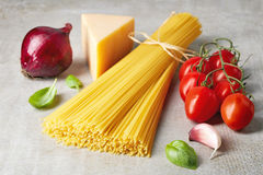 Spaghetti pasta, cheese and vegetables on grey stone table Stock Photography