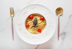 Spaghetti pasta with cherry tomatoes. On white plate stock photo