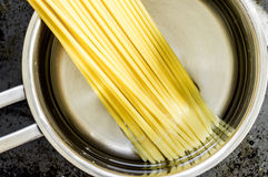 Spaghetti pasta is cooked in a pan Stock Photos