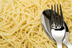 Spaghetti pasta with fork and spoon Stock Images