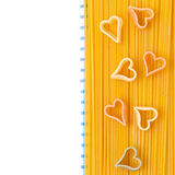 Spaghetti and pasta in the form of heart on a napkin, isolated Stock Photography