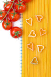 Spaghetti and pasta in the form of heart, top view Stock Photos