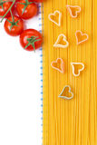Spaghetti and pasta in the form of heart, top view, isolated Stock Image