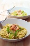 Spaghetti pasta with fresh shrimps and zucchini Royalty Free Stock Photos