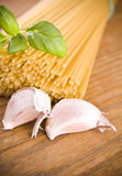 Spaghetti pasta with garlic and green basil Stock Image
