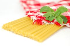 Spaghetti pasta and green stevia herb Stock Photos