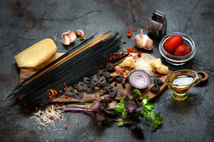 Spaghetti pasta ingredients.  on a gray background. Italian Cuisine Stock Photos