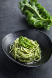 Spaghetti pasta with  kale pesto sauce and parmesan cheese Royalty Free Stock Images